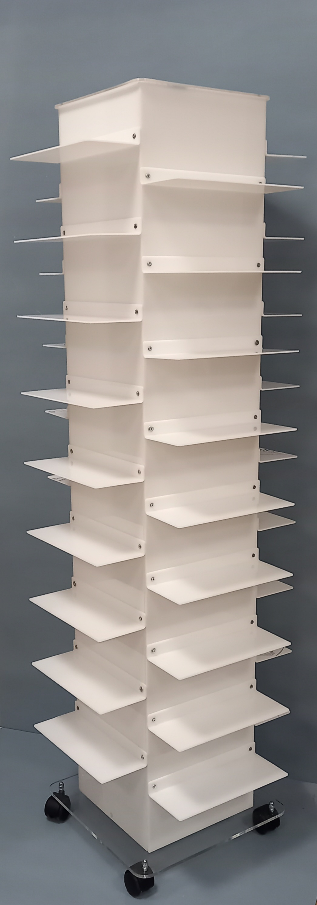 Clear plexiglass footwear display stand with 36 shelves and casters