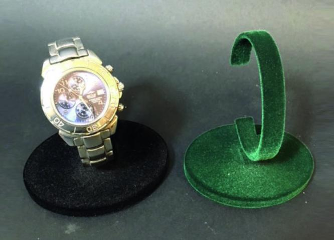 Black flocked watch display