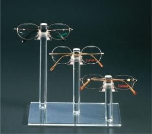 Clear plexiglass eyewear display with 3 holders
