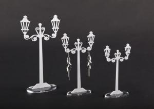 White plexiglass earring display